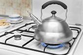 foto of kettles  - kettle on a gas stove flame burn not boiling - JPG