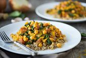image of chickpea  - Vegetarian curry dish with chickpeas tomatoes and spinach over brown rice - JPG