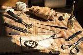picture of tool  - Leather craft tools on a wooden background - JPG