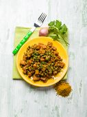 stock photo of stew  - seitan stew with peas and curry - JPG