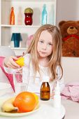 picture of home remedy  - Cute Sick Child Preparing Lemon Juice at home - JPG
