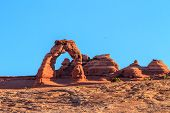 image of arch  - Delicate Arch at sun rise in Arches National Park Utah  - JPG