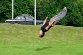 stock photo of parkour  - Parkour athlete performing in the city park - JPG