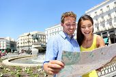 image of visitation  - Tourists couple with map in Madrid - JPG