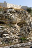 picture of golgotha  - Rock with the shape of a skull near the Garden Tomb in Jerusalem - JPG