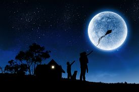 image of moon silhouette  - Silhouettes of happy family at night under full moon - JPG