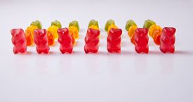stock photo of gummy bear  - Rows of colorful gummy bears isolated over white background - JPG