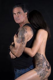 picture of swingers  - Portrait Of A Naked Woman Embracing Man From Behind - JPG