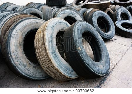 Car Tire Heap Align On Cement Ground, Used Tires