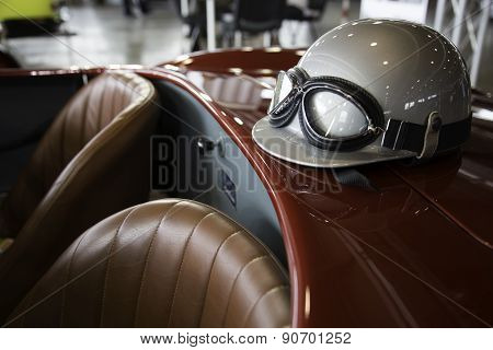 Helmet And Glasses On A Luxury Convertible Sports Car