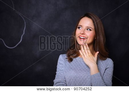 Portrait of happy smiling young covering with hand her mouth