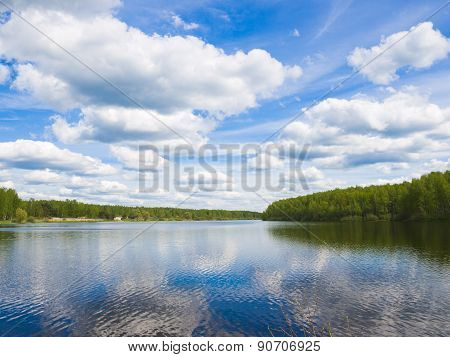 The sky with volumetric clouds over the lake on a sunny day