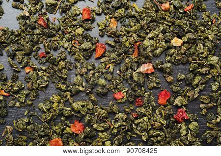 Oolong green tea with dried strawberries wooden table