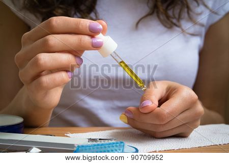 Female Hands Take Care Of Cuticles With Oil