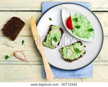Canape With Cottage Cheese, Greens And A Garden Radish.
