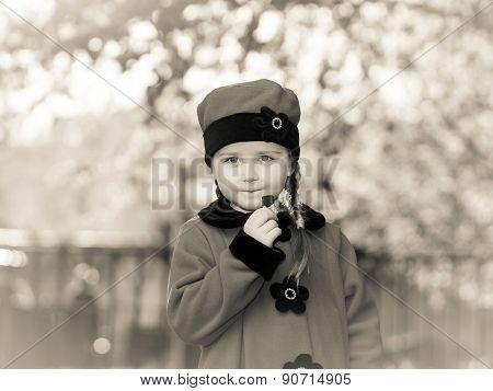 Cute Little Girl Dressed In Retro Coat Posing Near Oldtimer Car