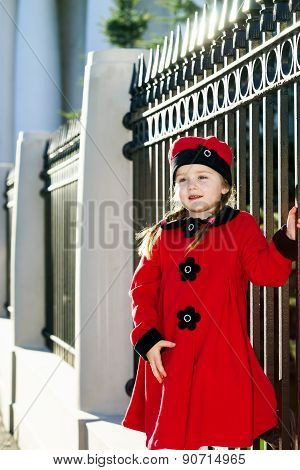 Cute Little Girl Dressed In Old-style Coat Posing On The Street