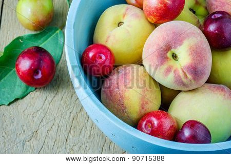Juicy Peaches And Apricots In Wooden Bowl