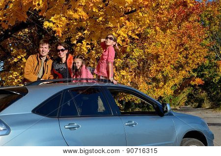 Car trip on autumn family vacation, happy parents and kids travel and have fun, car insurance