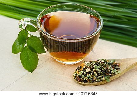 Cup Glass Of Tea  On A Blurred Background Of Nature.