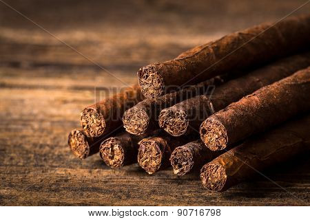 Quality Cigars On An Old Wooden Table