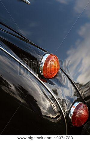 Brake light and turn signal on classic black car