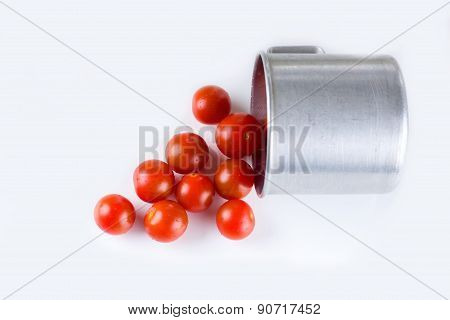 Red Cherry Tomatoes With Water Dropes Spilled From Aluminum Cup