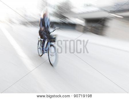 Woman On Blue Bike