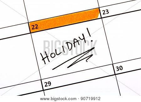 Holiday Date Written On A Calendar