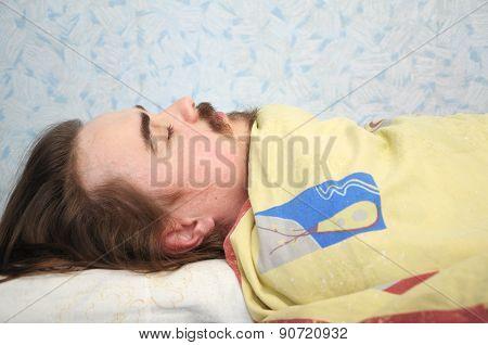 Man Sleeping Rolled In Blanket