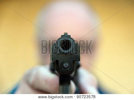 Man Aiming Gun