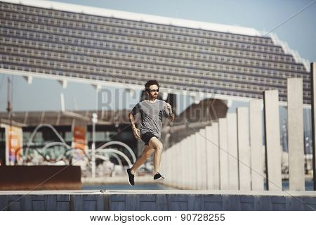 Running Athlete Man. Male Runner Sprinting During Outdoors Training. Athletic Fit Young Sport Fitnes
