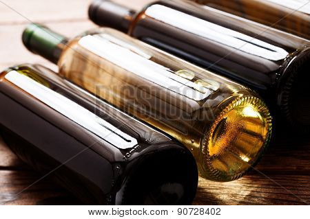 Wine bottles on wooden background