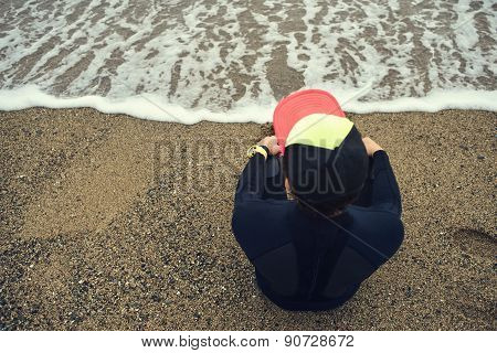 Handsome Young Surfer Man Sitting At Sand Near Ocean, Young Beautiful Surfer Man