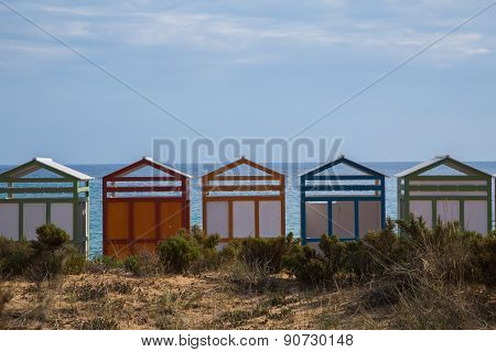 Colorful beach huts in good weather