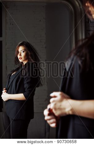 Portrait Of Seductive Young Woman Looking Into Mirror