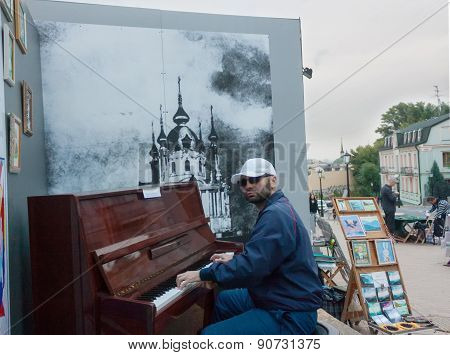 Ukraine, Kiev - September 9,2013: Andrew's Descent, Casual Passer Plays The Piano