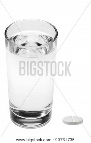 aspirin pills and glass of water isolated on white