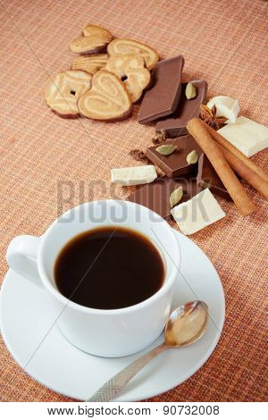 Cup Of Coffee With Cookies, Chocolate And Spices On A Table. Selective Focus On Cup
