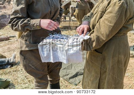 two soldiers in uniform with medical instruments