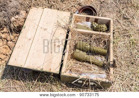 grenades in a wooden box with straw