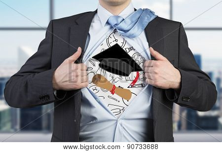 Young Student Is Tearing The Shirt. Graduation Attributes Are Drawn On The Chest. The Concept Of The