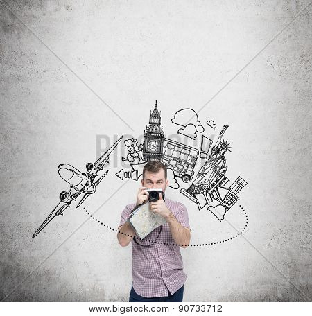 Young Handsome Traveller Is Taking A Picturesque Photo. London, New York Symbols Background