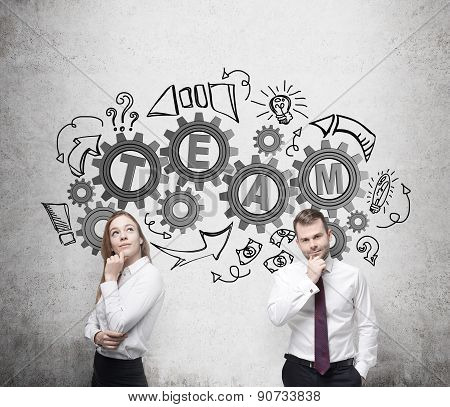 Business Couple Are Thinking About Cooperation In A Business Project. Drawn Gears On The Wall With T
