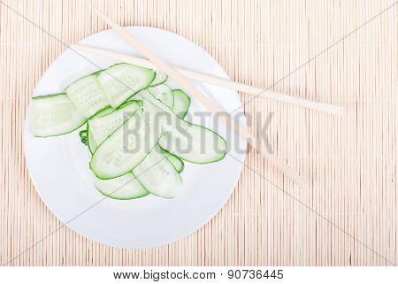 Japanese Cucumber Salad With Thinly Sliced Cucumbers In White Plate Japanese Shelves, Rests On A Bri