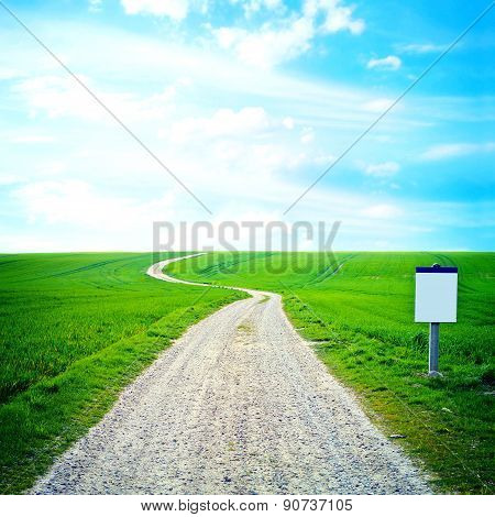 Green Field And Blue Sky Image.