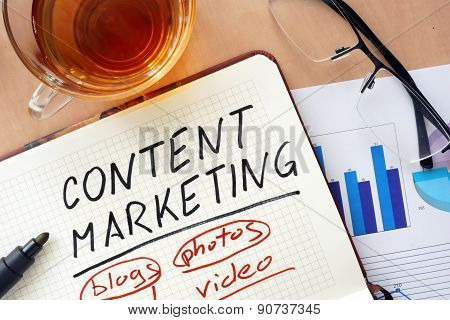 Notepad with words content marketing concept.
