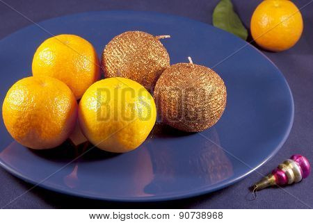 Tangerines on a blue plate