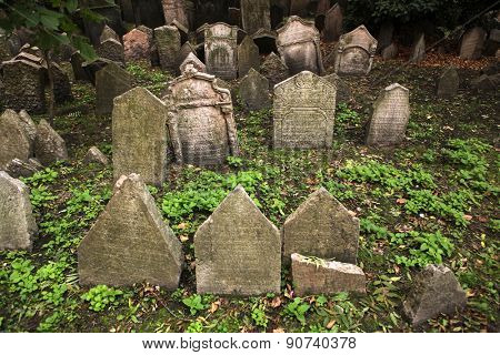PRAGUE, CZECH REPUBLIC - OCTOBER 15, 2012: Abandoned tombstones at the Old Jewish Cemetery in Prague, Czech Republic.