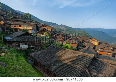 MAY 24, 2010 - GUANGXI, CHINA: Traditional multi-storey wooden buildings fill the hill slopes of Longshan in Guangxi province. Many of the buildings are converted to hotels to cater to tourists.